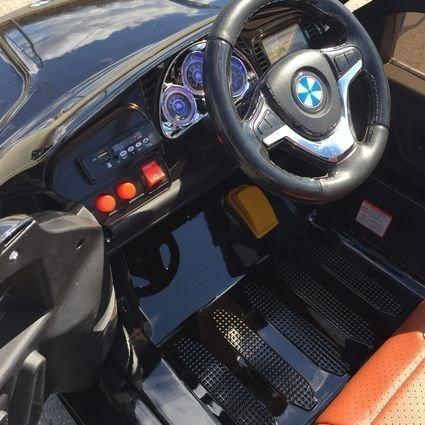 Электромобиль BMW X5 F15 черный (колеса резина, кресло кожа, пульт, музыка, усиленный аккумулятор)